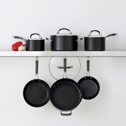 Anolon Endurance Plus products, 3 pots and 3 pans, are decorated on a white wall